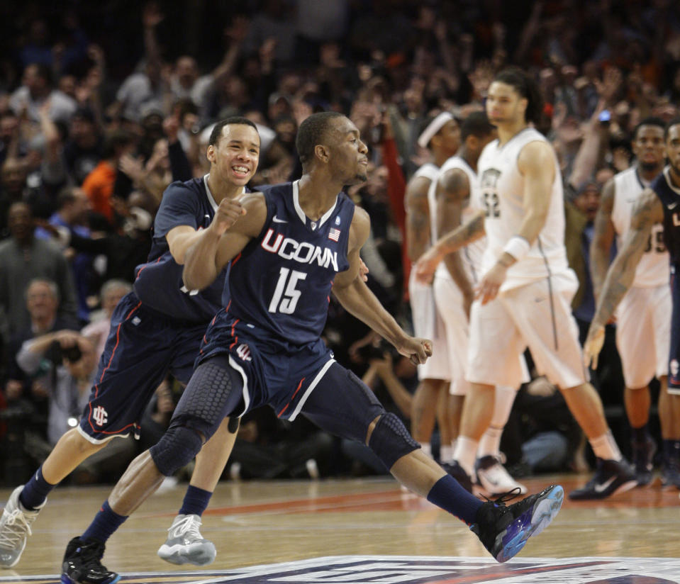 FILE - Connecticut's Kemba Walker (15) celebrates scoring the winning goal with teammate Shabazz Napier, in the final seconds of the second half of an NCAA college basketball game against Pittsburgh in the Big East Championship at Madison Square Garden in New York, in this Thursday, March 10, 2011, file photo. Connecticut defeated Pittsburgh 76-74. The New York Knicks have been looking long for a point guard and didn't have to search too far for their new one. Kemba Walker is from New York and is coming back to the Madison Square Garden court where he's had plenty of success already. (AP Photo/Mary Altaffer, File)