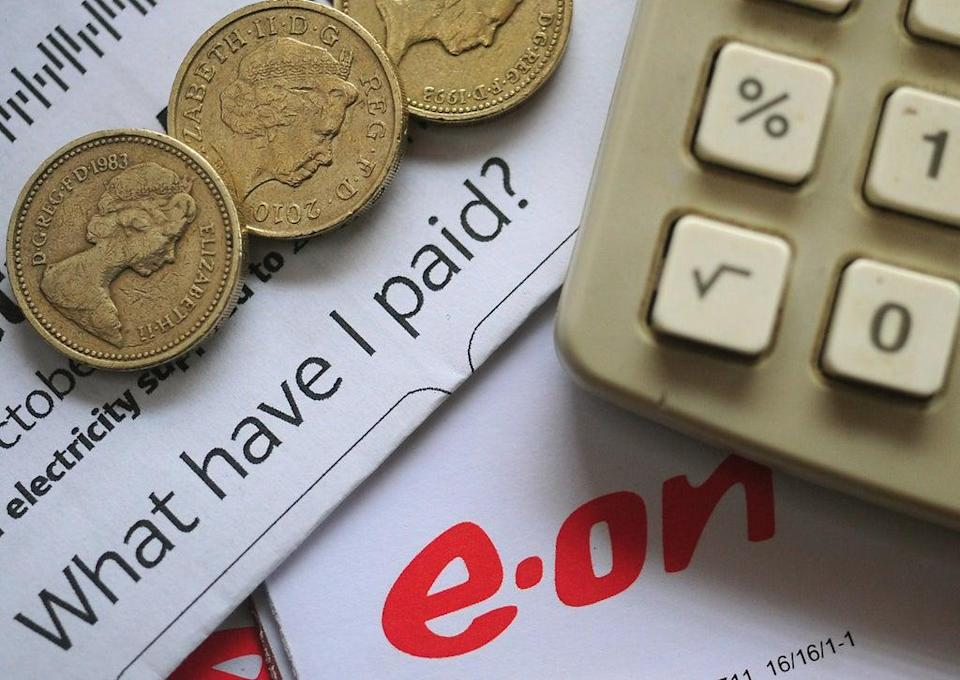 An EON energy bill with pound coins and a calculator.  (PA Archive)