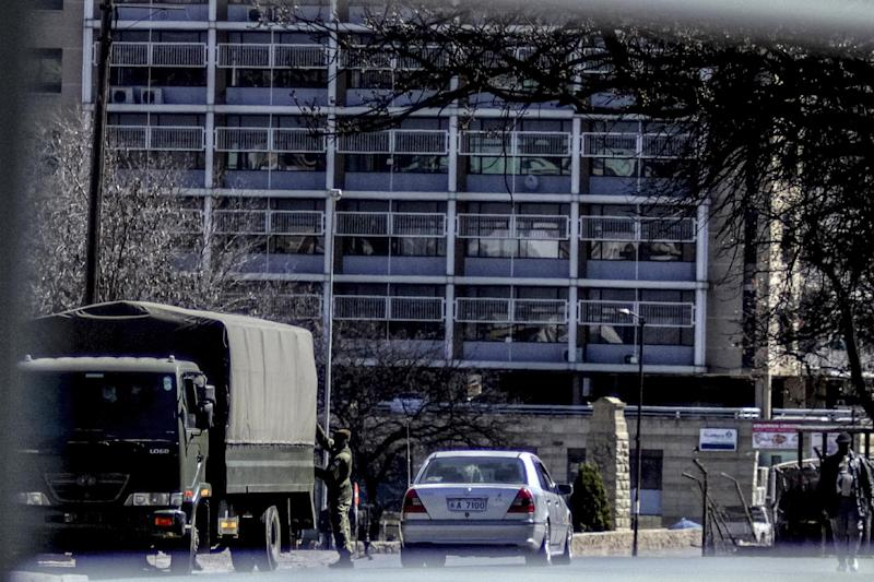 Lesotho troops leave the Central Police Office in Maseru after seizing control of several police stations in the capital on August 30 2014 (AFP Photo/)
