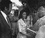 "FILE - Ambassador Andrew Young, from left, talks to actress Cicely Tyson and Rev. Martin Luther King, Sr. on the set of ""Martin Luther King, Jr."" being filmed in Macon in 1977. Tyson, the pioneering Black actress who gained an Oscar nomination for her role as the sharecropper's wife in ""Sounder,"" a Tony Award in 2013 at age 88 and touched TV viewers' hearts in ""The Autobiography of Miss Jane Pittman,"" has died. She was 96. Tyson's death was announced by her family, via her manager Larry Thompson, who did not immediately provide additional details. (AP Photo, File)"