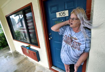 Rachel Ellison stands in the doorway to her apartment at the Lighthouse Motel, where she planned to ride out Hurricane Michael, in Panacea, Florida, U.S., October 10, 2018.  REUTERS/Steve Nesius
