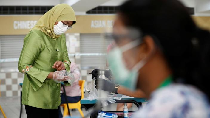 Voting took place with face masks and plastic gloves