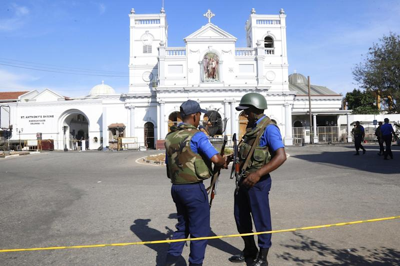 Sri Lankan security personal stand guard outside St. Anthony's Church in Kochchikade, Colombo (EPA)