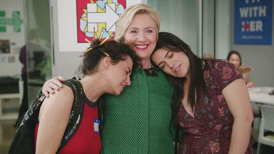 <p>The presidential candidate made a brief, but shining cameo on the show after Ilana landed a job with the campaign. Ilana attempted to cold-call voters, but soon learned this was a nonpaying gig. And just as she and Abbi were about to leave the office, in sailed HRC. The two totally lost their minds and even got a hug. #BroadsWithHer. —<em>KW</em><br>(Photo: Comedy Central) </p>