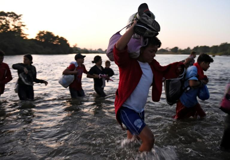 Central American migrants cross the Suchiate River on January 23