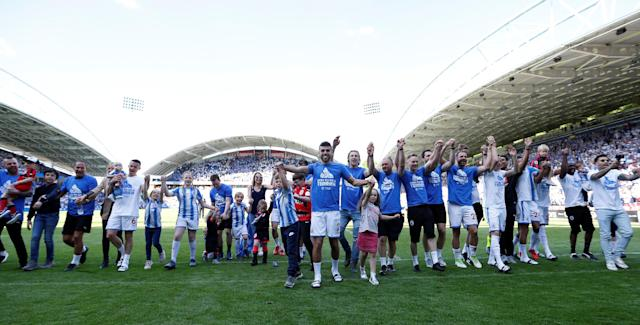 "Soccer Football - Premier League - Huddersfield Town vs Arsenal - John Smith's Stadium, Huddersfield, Britain - May 13, 2018 Huddersfield Town players celebrate in front of the fans at the end of the match Action Images via Reuters/Andrew Boyers EDITORIAL USE ONLY. No use with unauthorized audio, video, data, fixture lists, club/league logos or ""live"" services. Online in-match use limited to 75 images, no video emulation. No use in betting, games or single club/league/player publications. Please contact your account representative for further details."