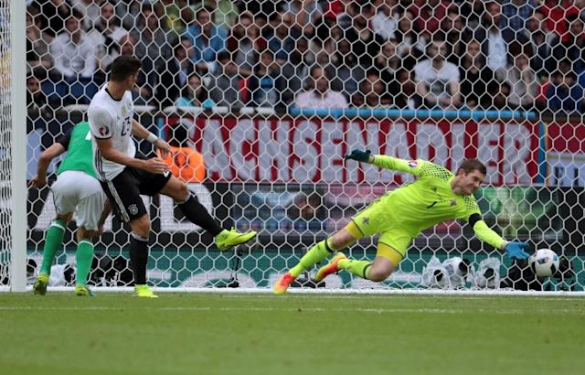 Northern Ireland's goalkeeper Michael McGovern stops a goal attempt by Germany's forward Mario Gomez during the Euro 2016 group C football match between Northern Ireland and Germany at the Parc des Princes stadium in Paris on June 21, 2016. (AFP Photo/Kenzo Tribouillard)