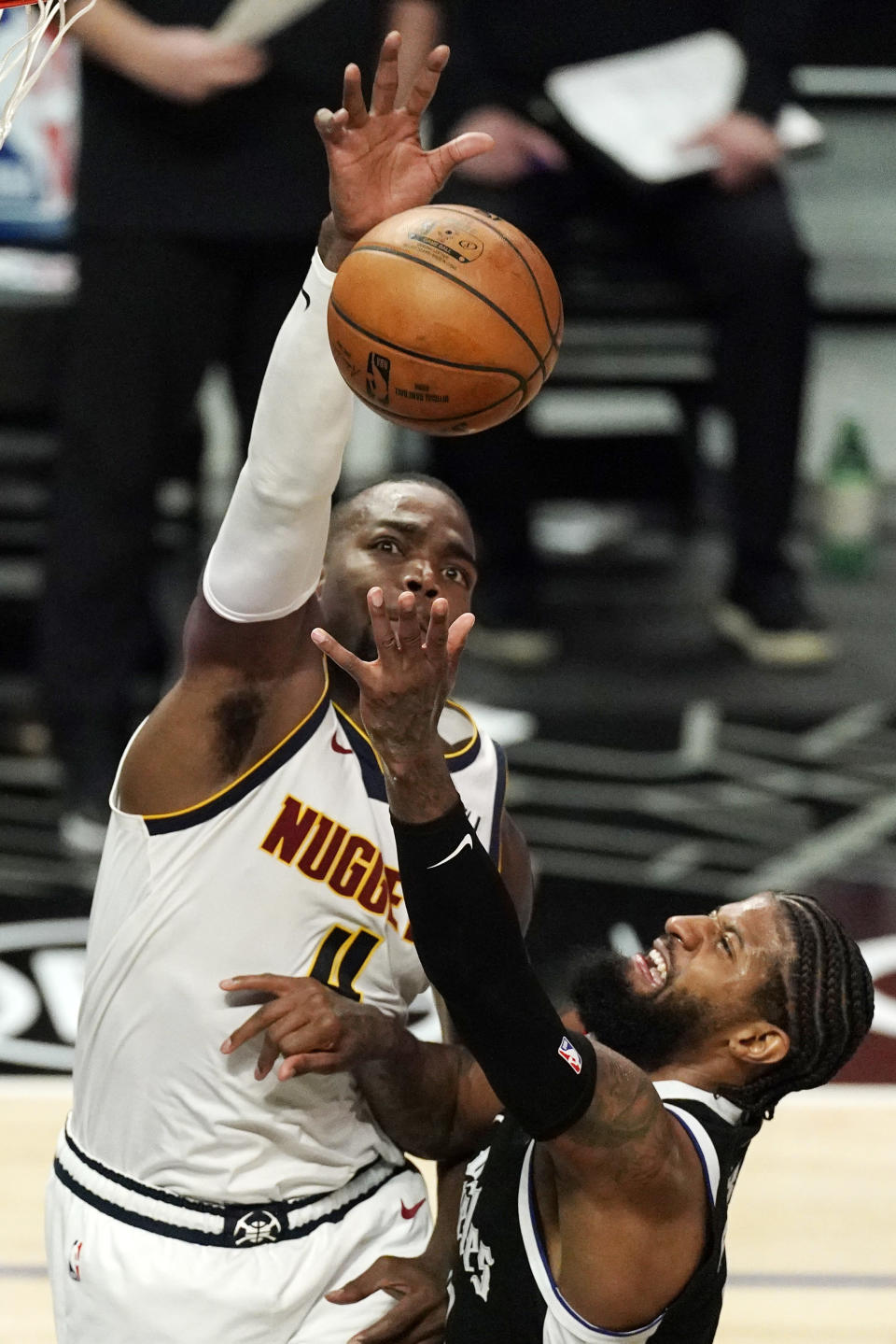 Los Angeles Clippers guard Paul George, right, shoots as Denver Nuggets forward Paul Millsap defends during the first half of an NBA basketball game Saturday, May 1, 2021, in Los Angeles. (AP Photo/Mark J. Terrill)
