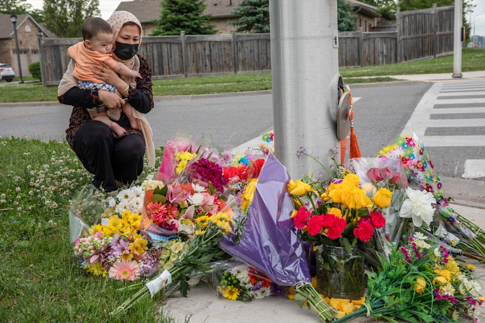 <p>Nafisa Azima and her daughter Seena Safdari attend a memorial at the location where a family of five was hit by a driver, in London, Ont., Monday, June 7, 2021. Four of the members of the family died and one is in critical condition. A 20 year old male has been charged with four counts of first degree murder and count of attempted murder in connection with the crime. THE CANADIAN PRESS/Brett Gundlock</p>