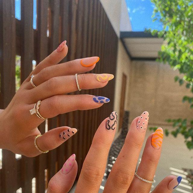 """<p>These nails are a work of ART! Queen of extra nail designs, Kylie Jenner, is out here rocking Instagram's favorite 2020 nail trend: mismatched nails. She went abstract on all ten fingers for a super funky look that low-key belongs in a museum.</p><p><a href=""""https://www.instagram.com/p/CCXMq0Qnlws/"""" rel=""""nofollow noopener"""" target=""""_blank"""" data-ylk=""""slk:See the original post on Instagram"""" class=""""link rapid-noclick-resp"""">See the original post on Instagram</a></p>"""