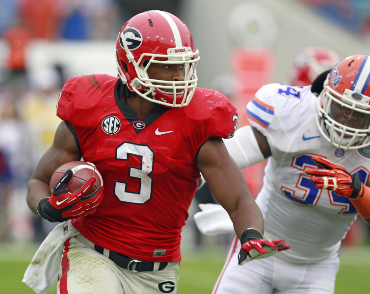 CORRECTS CITY TO JACKSONVILLE, NOT GAINESVILLE - Georgia running back Todd Gurley (3) gets around Florida linebacker Lerentee McCray for yardage during the first half of an NCAA college football game, Saturday, Oct. 27, 2012, in Jacksonville, Fla. (AP Photo/John Raoux)