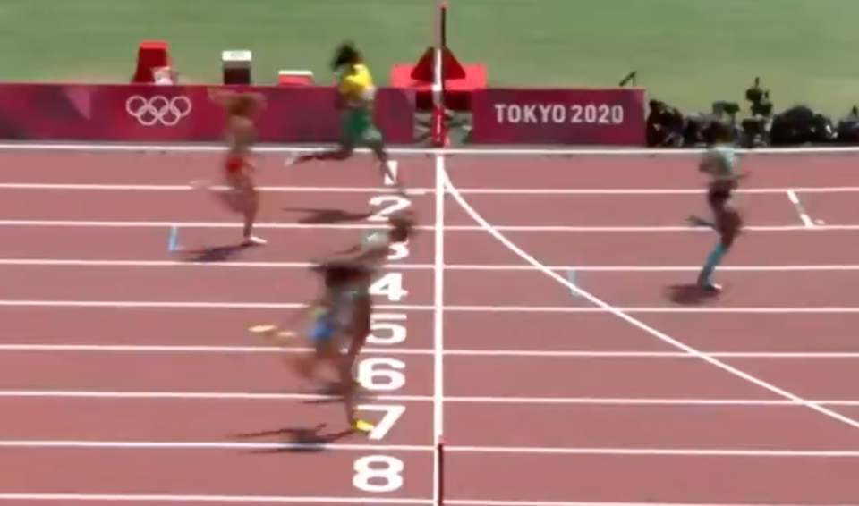 Shericka Jackson, pictured top in yellow, slowed down in the final yards of her 200m heat while in second place and ended up in fourth. (BBC screengrab)