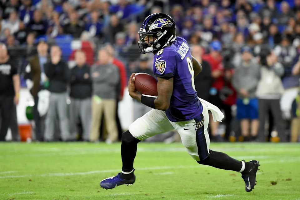 BALTIMORE, MARYLAND - JANUARY 11: Lamar Jackson #8 of the Baltimore Ravens runs against the Tennessee Titans during the AFC Divisional Playoff game at M&T Bank Stadium on January 11, 2020 in Baltimore, Maryland. (Photo by Will Newton/Getty Images)