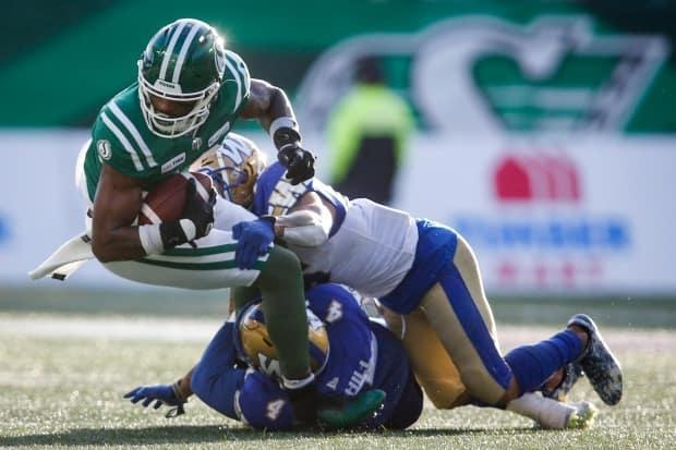 CFL players will have to produce four negative COVID-19 tests before they are permitted to join team training camps. (Jeff McIntosh/The Canadian Press - image credit)