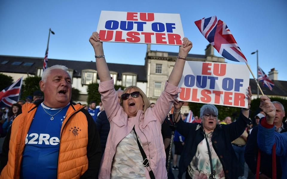 Loyalist band members and supporters make their way through Newtownards town centre during an anti-Northern Ireland Protocol protest rally on June 18 - Charles McQuillan/Getty