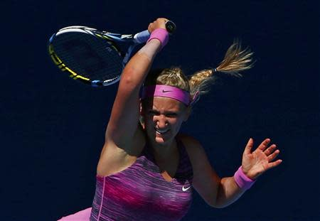 Victoria Azarenka of Belarus hits a return to Johanna Larsson of Sweden during their women's singles match at the Australian Open 2014 tennis tournament in Melbourne January 14, 2014. REUTERS/Petar Kujundzic