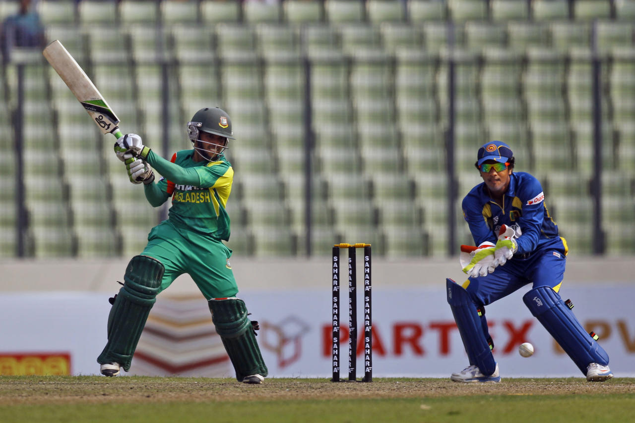 Bangladeshi Mominul Haque plays a shot during the third one day international cricket against Sri Lanka in Dhaka, Bangladesh, Saturday, Feb. 22, 2014. (AP Photo/A.M. Ahad)