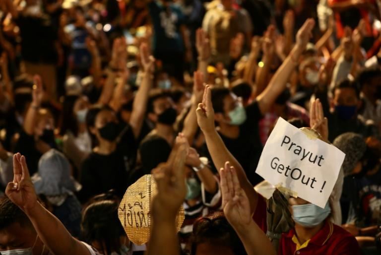 Protesters display a sign calling for the resignation of Thailand's prime minister at a rally in Bangkok
