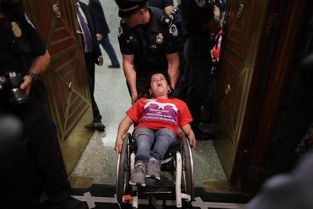 U.S. Capitol Police arrest activistsfrom handicap advocacy organizations as protest during aSenate Finance Committee hearing about the proposed Graham-Cassidy Healthcare Bill in the Dirksen Senate Office Building on Capitol Hill September 25, 2017 in Washington, DC. (Chip Somodevilla via Getty Images)