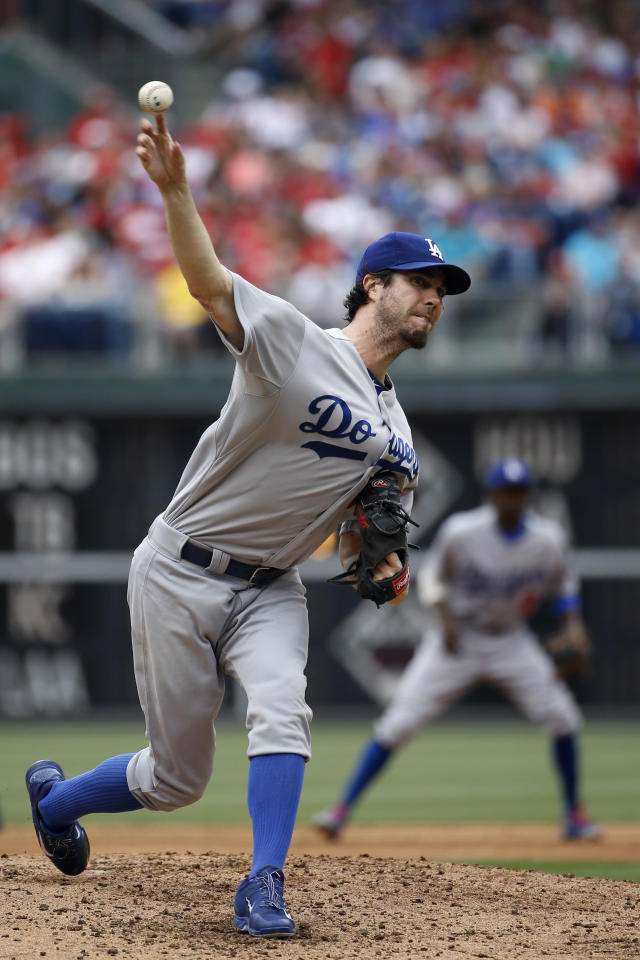 Los Angeles Dodgers' Dan Haren pitches during the second inning of a baseball game against the Philadelphia Phillies, Saturday, May 24, 2014, in Philadelphia. (AP Photo/Matt Slocum)
