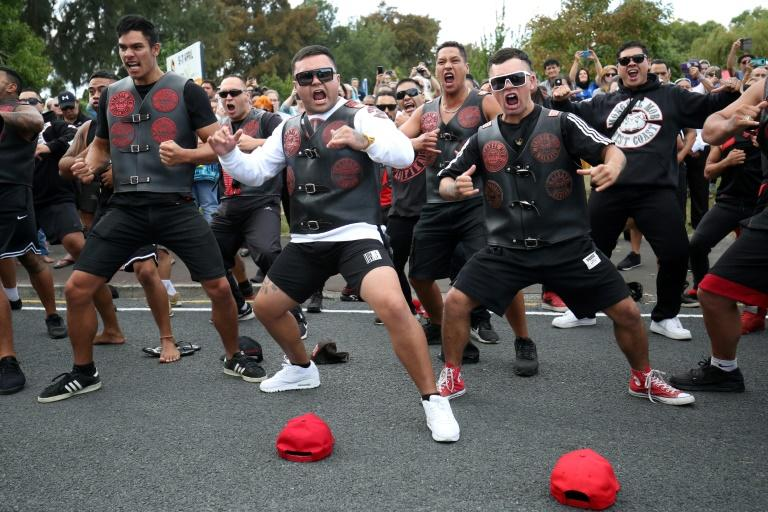 Members of a New Zealand biker gang perform the haka in tribute to those killed in the March 15 Christchurch twin mosque massacre, outside the Jamia Masjid mosque in Hamilton