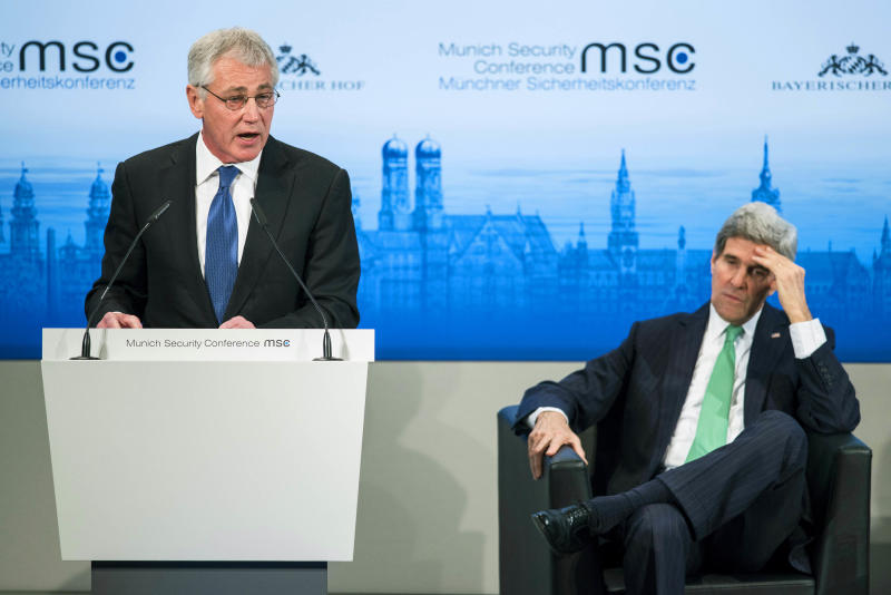 US Secretary of State John Kerry, right, listens while US Secretary of Defense Chuck Hagel , left, speaks during the Munich Security Conference at the Bayerischer Hof Hotel Saturday feb. 1, 2014, in Munich, southern Germany. The annual meeting was set to deal with thorny international issues, from the Syrian war and Ukraine's turmoil to Iran's nuclear programme and US online surveillance. (AP Photo/Brendan Smialowski,Pool)