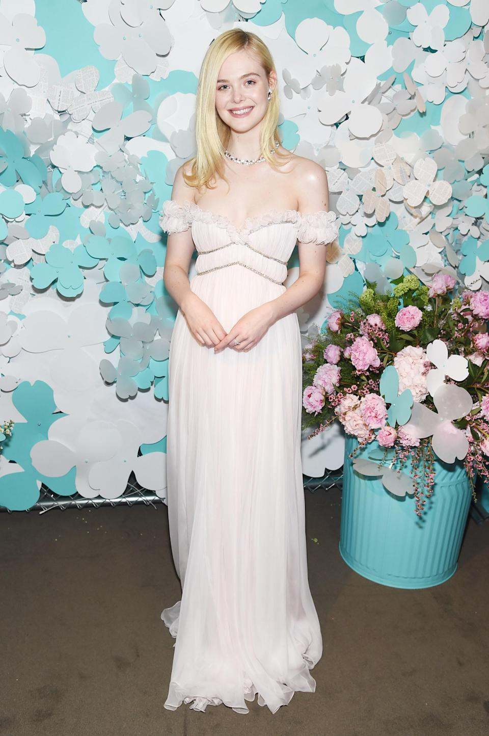 WHO: Elle Fanning<br> WHAT: Giambattista Valli Haute Couture<br> WHERE: At the Tiffany & Co. Paper Flower launch, New York City<br> WHEN: May 3, 2018