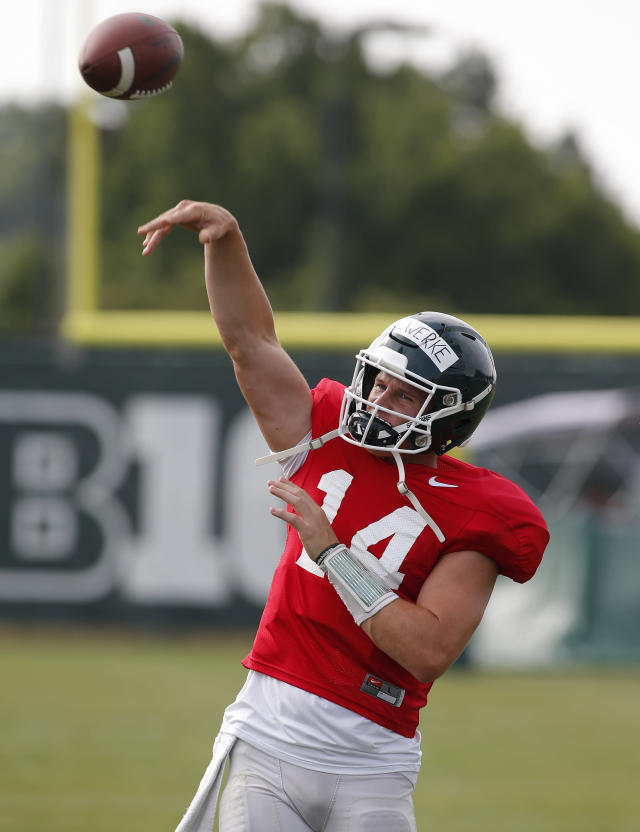 Michigan State quarterback Brian Lewerke throws a pass during an NCAA college football practice, Monday, Aug. 12, 2019, in East Lansing, Mich. (AP Photo/Al Goldis)