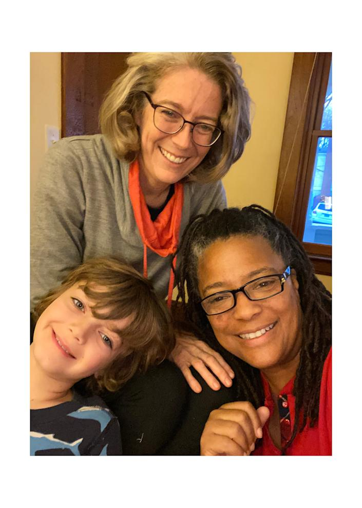 Nadine Smith, bottom right, with wife Andrea and son Logan.