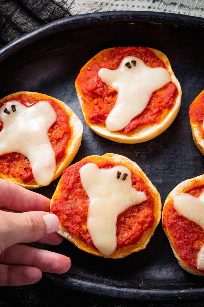 "<p>Kids will love these spooky pizzas any time of year.</p><p>Get the recipe from <a href=""https://www.delish.com/holiday-recipes/halloween/recipes/a49353/ghost-pizza-bagels-recipe/"" rel=""nofollow noopener"" target=""_blank"" data-ylk=""slk:Delish"" class=""link rapid-noclick-resp"">Delish</a>.</p>"