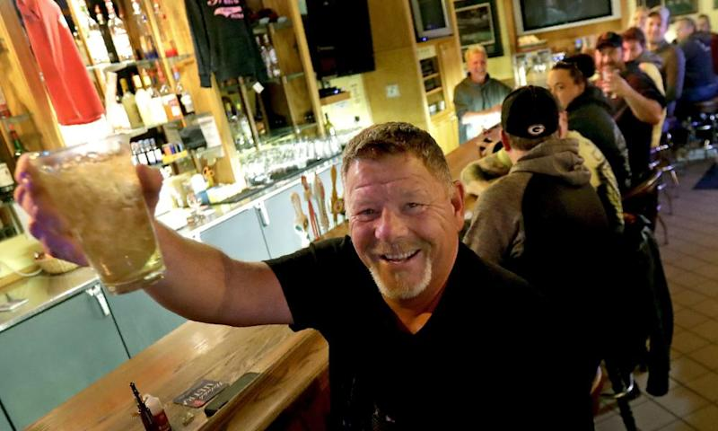 A bar patron in Appleton, Wisconsin, toasts the state supreme court's decision to end the lockdown on Wednesday.