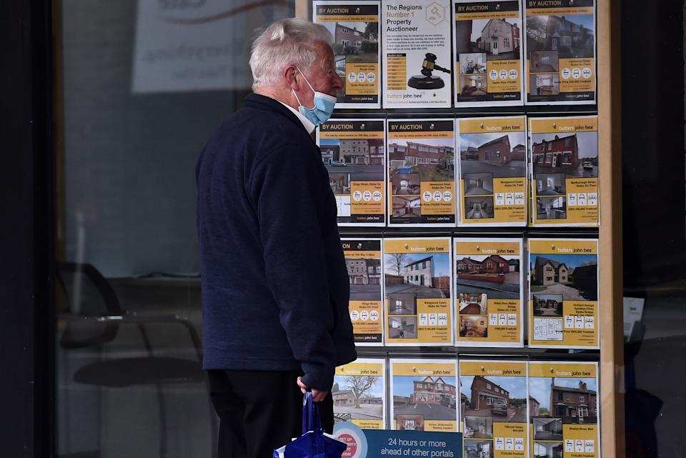 A man looking at houses for sale at an estate agents in Stoke-on-Trent, England. Photo: Nathan Stirk/Getty Images