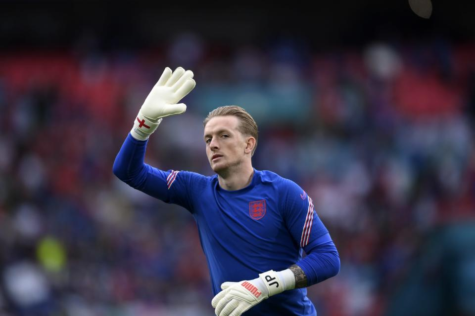 England's goalkeeper Jordan Pickford waves to the fans before the Euro 2020 soccer final match between England and Italy at Wembley stadium in London, Sunday, July 11, 2021. (Laurence Griffiths/Pool via AP)