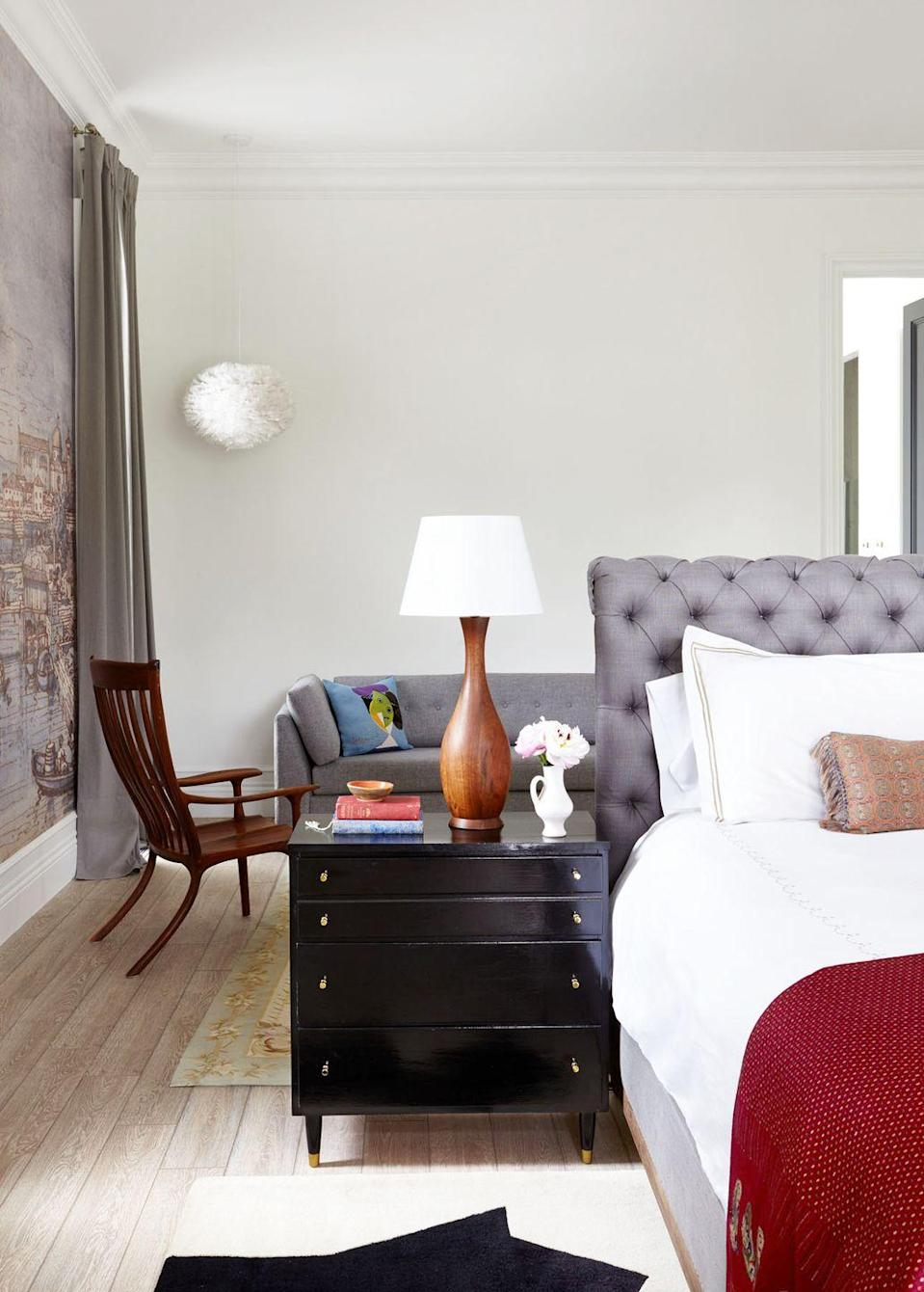 "<p>Challenge expected layouts and experiment with new ones—you may find that something less cookie-cutter works better for your space. For example, in this bedroom by <a href=""http://www.rajirm.com/"" rel=""nofollow noopener"" target=""_blank"" data-ylk=""slk:Raji Radhakrishnan"" class=""link rapid-noclick-resp"">Raji Radhakrishnan</a>, the floating bed and bedside table help separate the space into separate zones, carving out a bonus sitting area and doubling use-case. </p>"