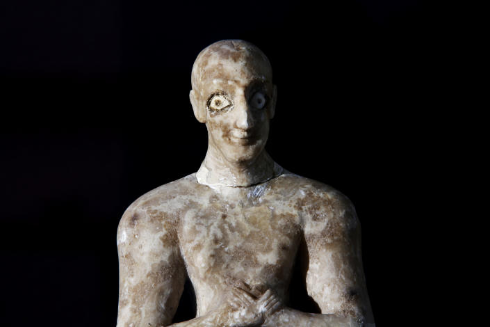 A recovered statue is displayed at the Iraqi National Museum in Baghdad, Iraq, Monday, April 1, 2013. Tens of thousands of artifacts chronicling some 7,000 years of civilization in Mesopotamia are believed to have been looted from Iraq in the chaos which followed the the US-led invasion in 2003. Despite international efforts to track items down, fewer than half of the artifacts have so far been retrieved. (AP Photo/Hadi Mizban)