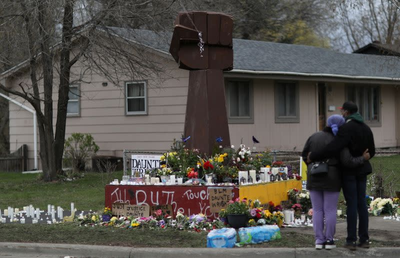 Friends mourn Daunte Wright at the site where he was killed by a Brooklyn Center police officer in Minnesota