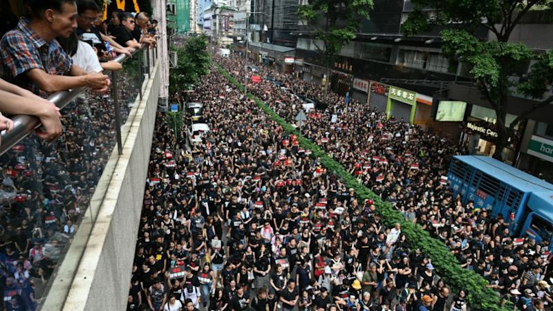 Thousands rally against extradition, prompting apology from Hong Kong leadership