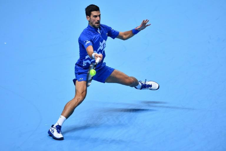 Novak Djokovic in action against Dominic Thiem in the last four of the ATP Finals