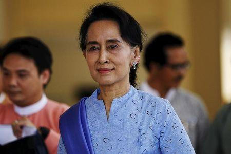 Myanmar's pro-democracy leader Aung San Suu Kyi talks to Reuters reporters during an exclusive interview in her office at the parliament in Naypyidaw