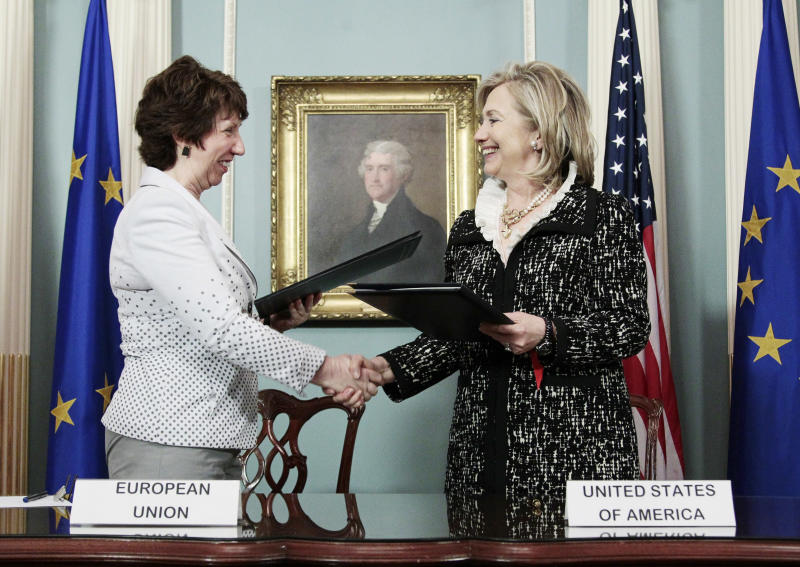 Secretary of State Hillary Rodham Clinton, right, and EU High Representative Lady Catherine Ashton, left, shake hands after signing of the US-EU framework at the US State Dept. Building in Washington, Tuesday, May 17, 2011. (AP Photo/Pablo Martinez Monsivais)