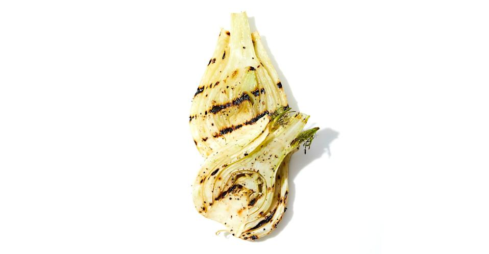 """Make sure to peel away the outermost layer from the fennel bulb; it's tough and fibrous and won't be good grilled. This recipe is from <a href=""""http://www.pytlosangeles.com/"""" rel=""""nofollow noopener"""" target=""""_blank"""" data-ylk=""""slk:P.Y.T."""" class=""""link rapid-noclick-resp"""">P.Y.T.</a> in Los Angeles, CA. <a href=""""https://www.bonappetit.com/recipe/grilled-fennel?mbid=synd_yahoo_rss"""" rel=""""nofollow noopener"""" target=""""_blank"""" data-ylk=""""slk:See recipe."""" class=""""link rapid-noclick-resp"""">See recipe.</a>"""
