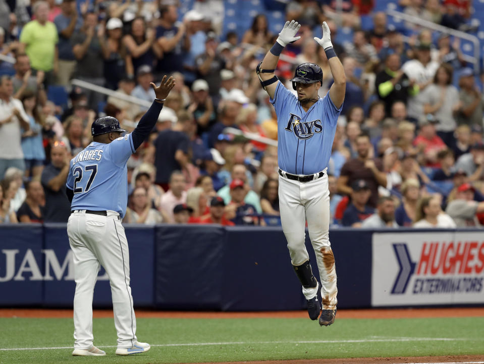 Tampa Bay Rays' Nate Lowe, right, celebrates with third base coach Rodney Linares (27) after hitting a two-run home run off Cleveland Indians starting pitcher Adam Plutko during the fourth inning of a baseball game Sunday, Sept. 1, 2019, in St. Petersburg, Fla. (AP Photo/Chris O'Meara)