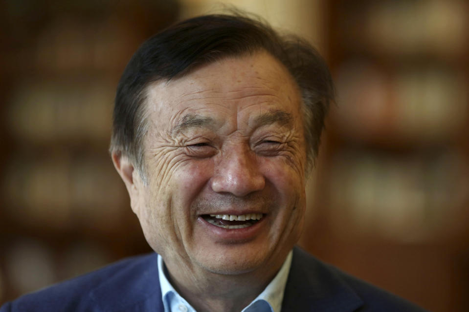 In this Aug. 20, 2019, photo, Huawei's founder Ren Zhengfei reacts as he chats with Huawei executives at the company campus in Shenzhen in Southern China's Guangdong province. Ren says its troubles with President Donald Trump are hardly the biggest crisis he has faced while working his way from rural poverty to the helm of China's first global tech brand. (AP Photo/Ng Han Guan)
