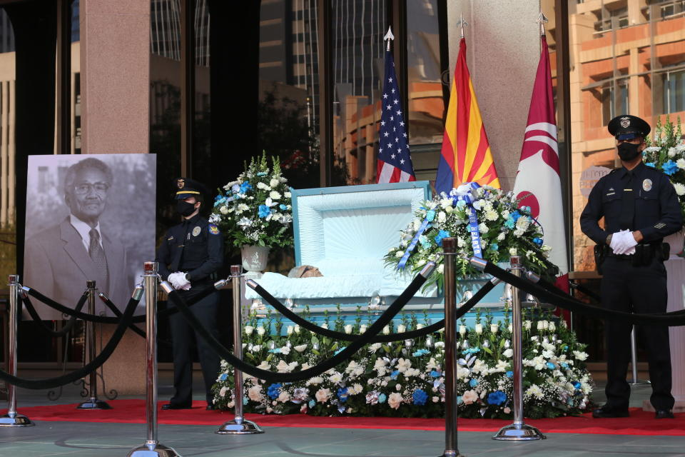 Calvin C. Goode is laid at state in front of Calvin C. Goode Municipal Building in Phoenix, Ariz on Saturday, Jan. 9, 2021. Family members and members of the community attended the public, socially distanced viewing for Goode who died on Wednesday, Dec. 23, 2020. He was 93. (AP Photo/Cheyanne Mumphrey)
