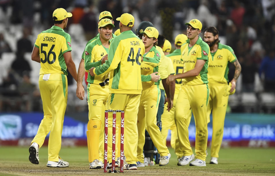 Australia celebrate winning the T20 series against South Africa at Newlands Cricket stadium in Cape Town, South Africa, Wednesday, Feb. 26, 2020.