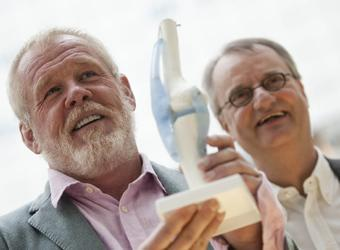 Actor Nick Nolte (left) holds a model of a knee joint next to doctor Peter Wehling in Dusseldorf, Germany in 2010