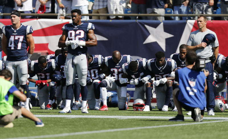 Members of the New England Patriots take a knee during the national anthem before a game against the Houston Texans at Gillette Stadium. (USA Today Sports / Reuters)