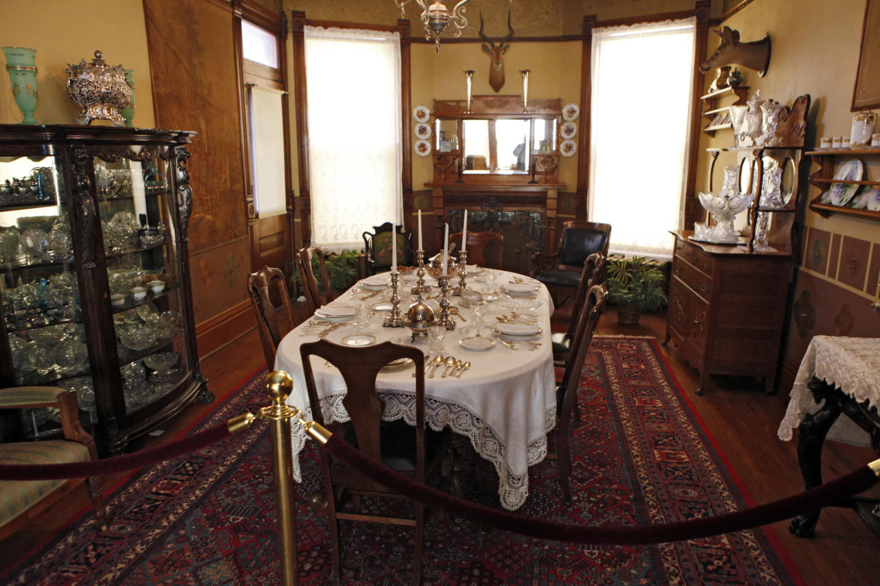 """This March 19, 2012 photo shows the dinning room in the Molly Brown House Museum in Denver. A few blocks from Colorado's state Capitol _ over 1700 miles from the Atlantic Ocean and a mile above sea level _ is a museum dedicated to a woman eclipsed by legend following the sinking of the Titantic. The """"unsinkable Molly Brown"""" moved into this stone Victorian home after she and her husband struck it rich at a gold mine in Colorado's mountains, nearly 20 years before she boarded the Titanic because it was the first boat she could get back home to visit her ailing grandson. (AP Photo/Ed Andrieski)"""