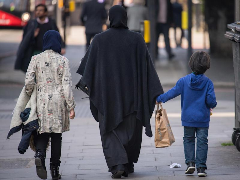A general view of two Muslim women and a child in London: PA