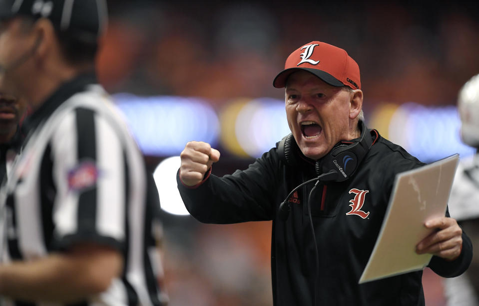 FILE - In this Nov. 9, 2018, file photo, Louisville head coach Bobby Petrino tries to get the referees attention during the first half of an NCAA college football game against Syracuse, in Syracuse, N.Y. Petrino, a coach with a track record of on-the-field success but off-the-field embarrassments, will be the next coach at Missouri State, the university said Wednesday, Jan. 15, 2020. (AP Photo/Adrian Kraus, File)